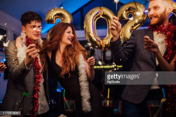 couples celebrating new year's eve - 2020 2029 stock pictures, royalty-free photos & images