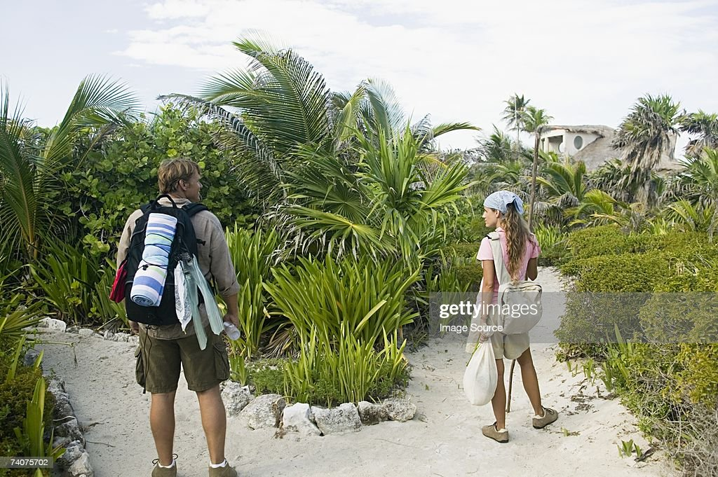Couples choosing different paths : Stock Photo