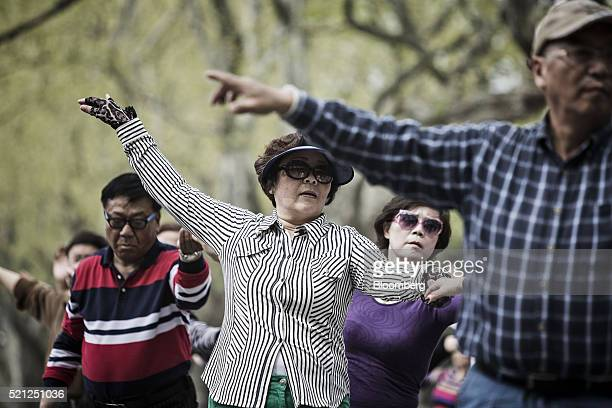Couples dance at Fuxing Park in Shanghai China on Sunday April 10 2016 China's economy stabilized last quarter and gathered pace in March as a surge...
