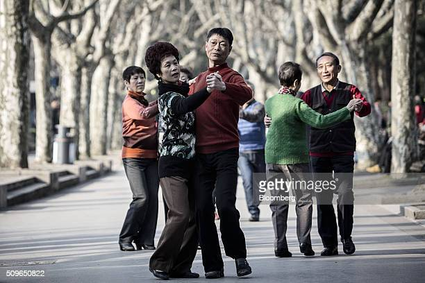 Couples dance at Fuxing Park in Shanghai China on Tuesday Feb 9 2016 The global equity bear market deepened in Asian trading with Japanese stocks...