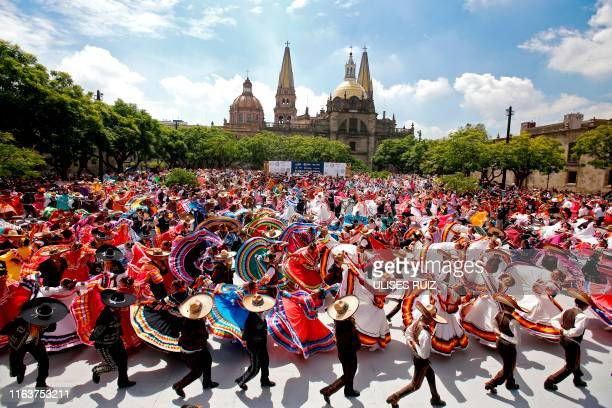 Couples dance to Mariachi traditional music to break the Guinness World Record of largest Mexican folk dance in Guadalajara, Jalisco state, Mexico,...