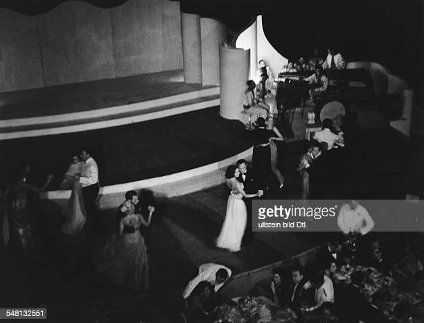 Couples dancing at a gala event in Palm Beach near Cannes on the Cote d'Azur 1938 Photographer Regine Relang Published by 'Die Dame' 13/1938 Vintage...