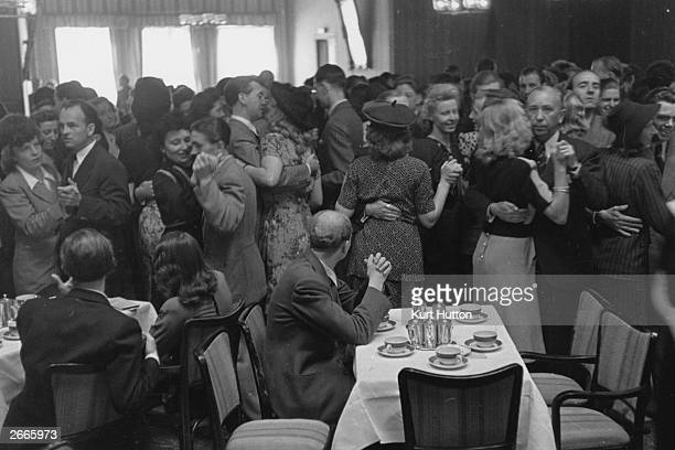 Couples dancing at a tea dance in Nuremberg Germany Original Publication Picture Post 4200 The Greatest Trial In History pub 1946