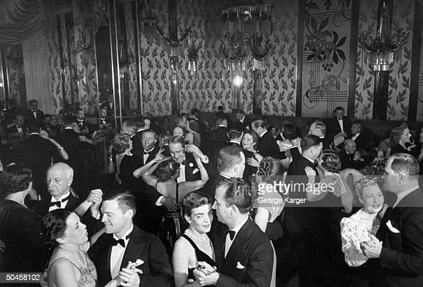 Couples dancing at the Iridium Room at the St. Regis Hotel.