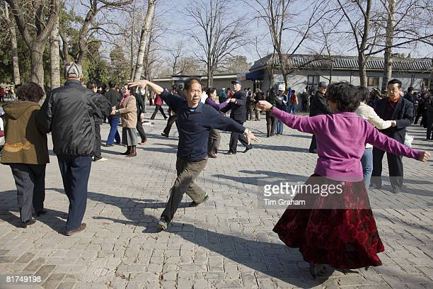 Couples dancing in park of the Temple of Heaven Beijing China