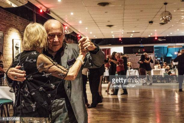 Couples dancing, Salon Canning, a milonga (tango dancing club which is like a social club in Buenos Aires for tango lovers), Palermo, Buenos Aires (the birthplace of tango), Argentina