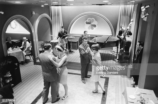 Couples dancing to music from a trio of piano bass and drums at the FiftyFive Buttery Bar restaurant 4th August 1966