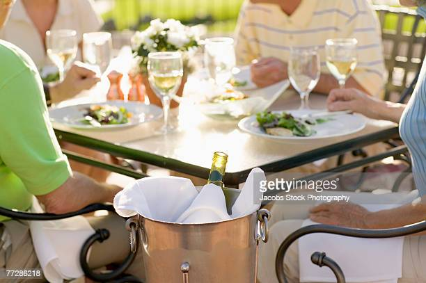 Couples dining outdoors