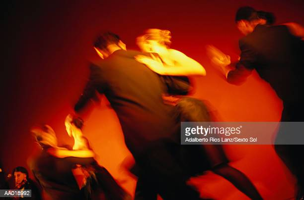 Couples doing the Tango, blurred motion