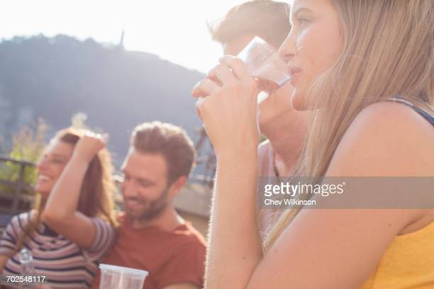 Couples drinking at roof terrace party