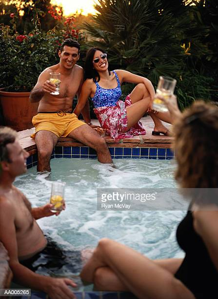 Couples Drinking Cocktails in a Hot Tub