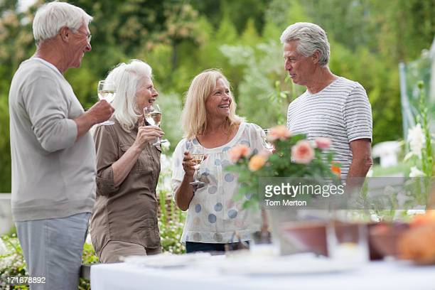 Couples drinking wine in garden