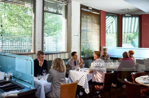 couples enjoying dinner in restaurant - indoors stock pictures, royalty-free photos & images