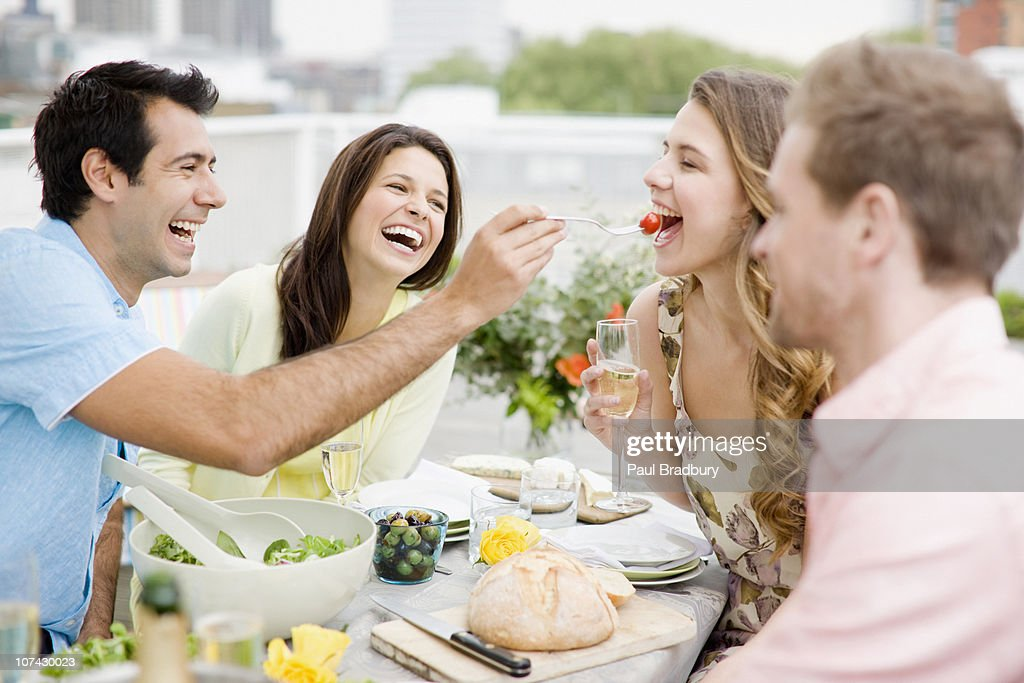 Couples enjoying party on balcony : Stock Photo