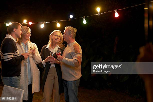 Couples enjoying red wine at porch