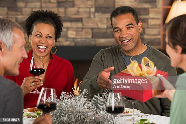 Couples exchanging Christmas gifts