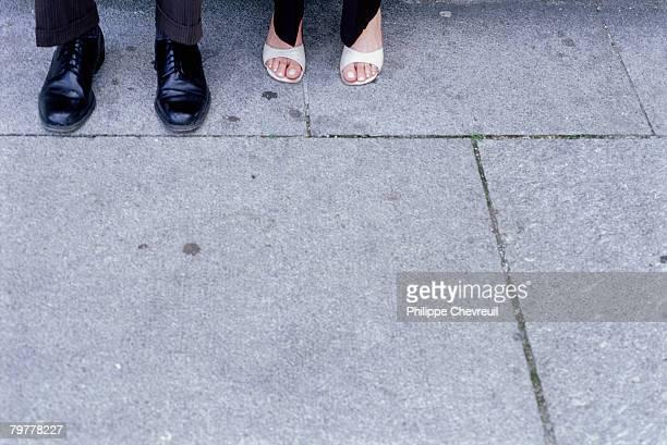 Couples Feet on Sidewalk