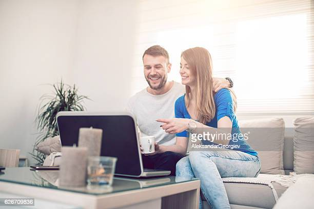 Couples First Coffee in Morning with Favorite Application on Laptop