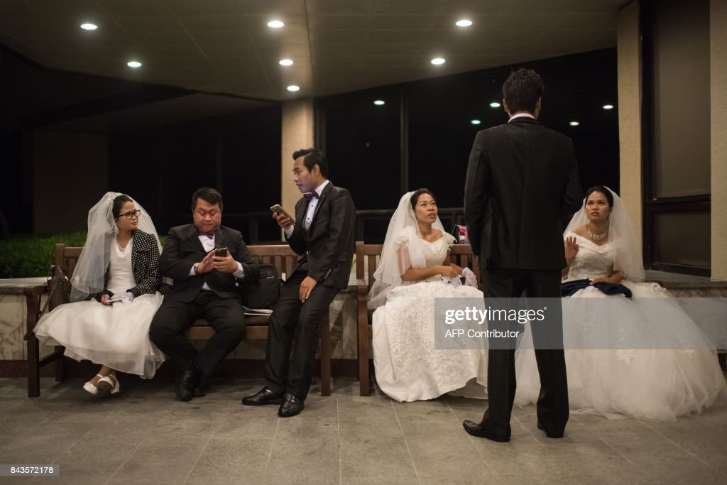 Couples Gather Before Taking Part In A Mass Wedding Ceremony Held By The Unification Church And