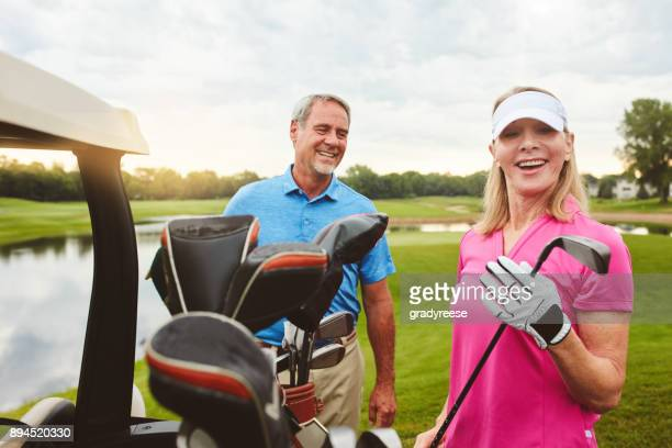 couple's golf - golfer stock pictures, royalty-free photos & images