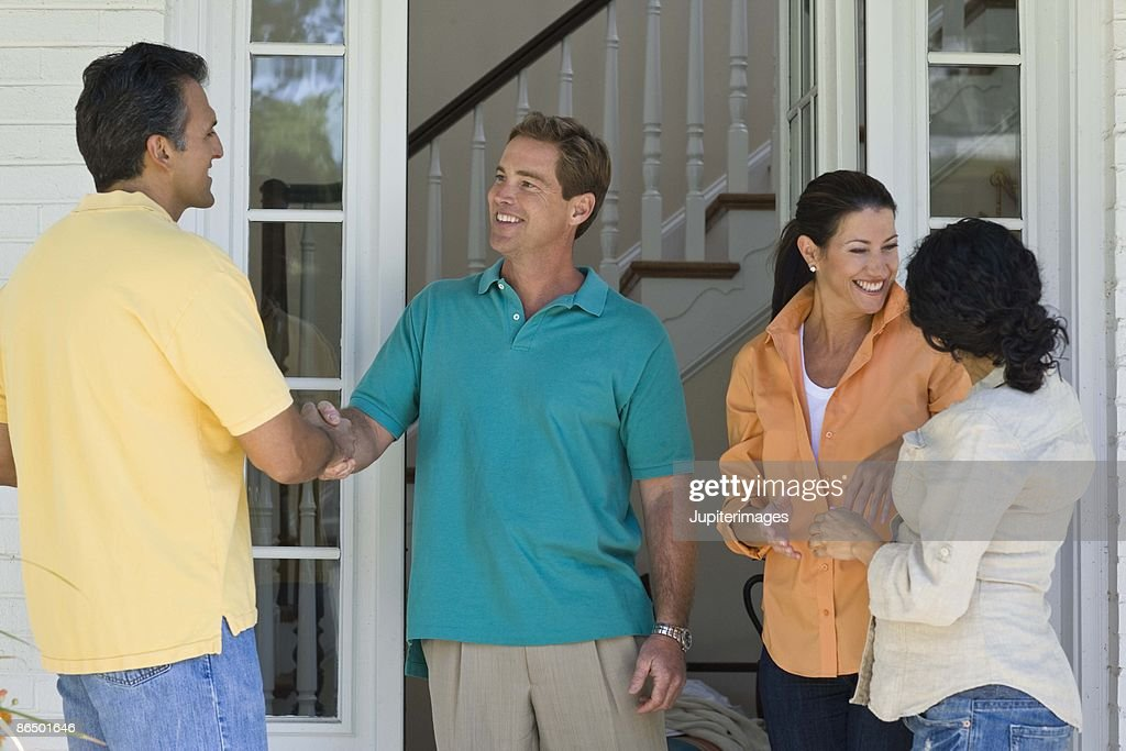 Couples greeting at house : Stock Photo
