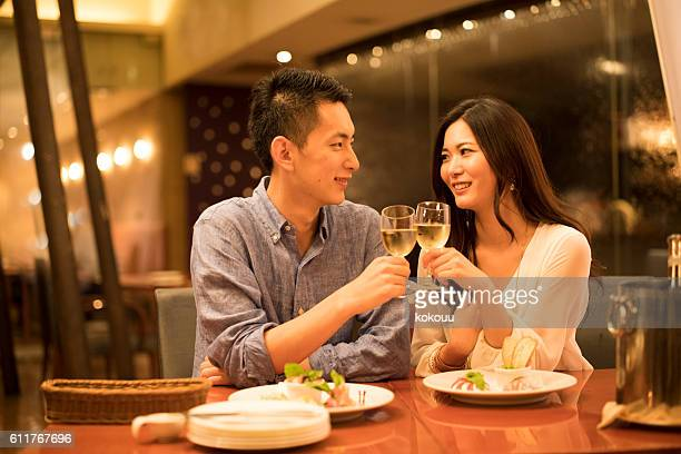 Couples have a toast at the restaurant