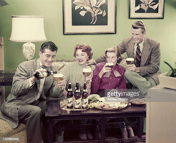 Couples having drink in living room