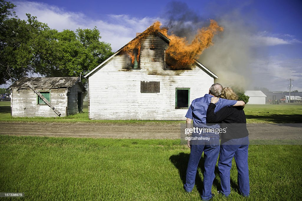Couple's House on Fire : Stock Photo