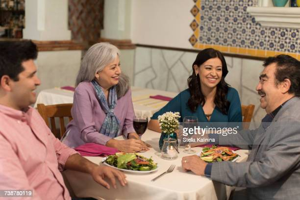 Couples laughing in restaurant