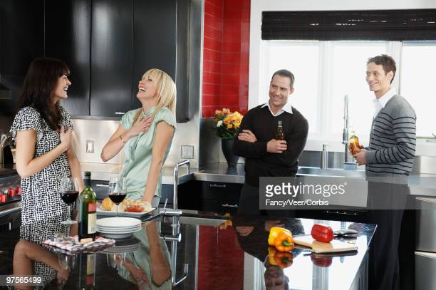 Couples laughing in the kitchen
