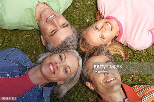 Couples lying down with heads together