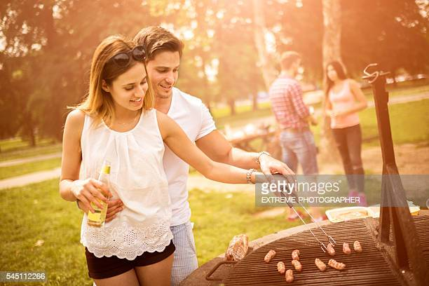 Couples on a barbecue picnic