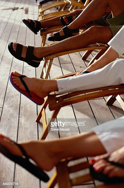 Couples on Deck Chairs of Cruise Ship