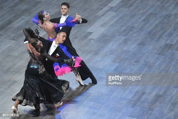 Couples Pacini/Galuppo of Italy and Gumeniuc/Kusnir of Moldavia compete during the Standard couple dance competition, at The World Games 2017, in the...