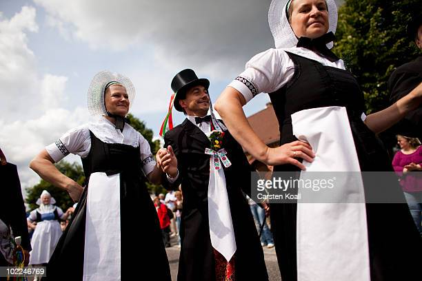 Couples perform a traditional sorbian wedding dance at the Sorbian procession on the occasion of the international bigpipe festival on June 20 2010...