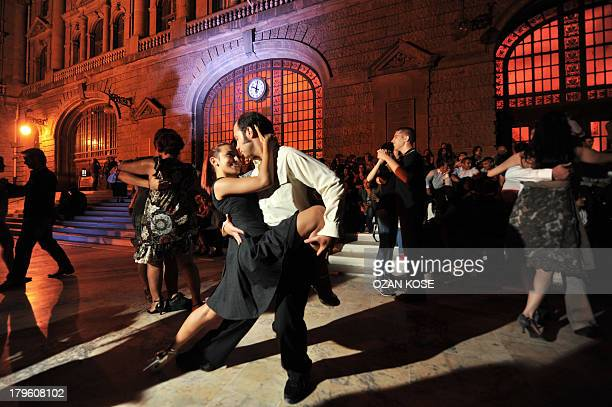 Couples perform the tango during a demonstration at the historic Haydarpasa train station on September 5 2013 in Istanbul Haydarpasa Railway Terminal...