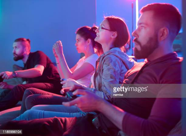couples playing competitive video games - esport stock pictures, royalty-free photos & images