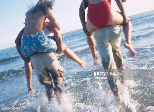 Couples Playing in Ocean