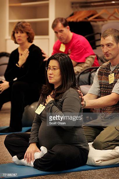 Couples practice relaxation during a birthing class at Northwestern Memorial Hospital October 16 2006 in Chicago Illinois The US population through a...