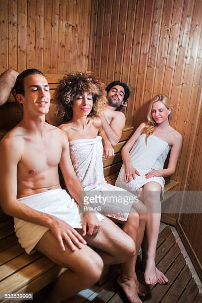 couples relaxing in sauna. - black woman in sauna stock pictures, royalty-free photos & images