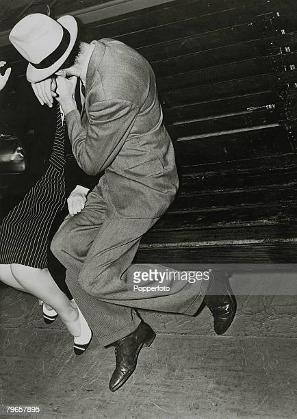 circa 1940 A man plants a kiss on a woman as he makes a grab for her on a seat on the showboat Kay Parsons during a moonlight trip on the Hudson...