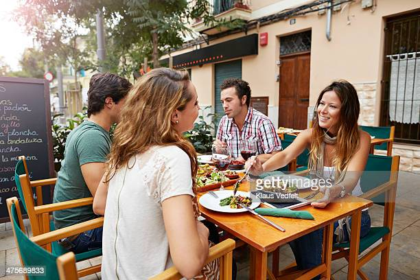 couples sharing food at tapas restaurant - klaus vedfelt mallorca stock pictures, royalty-free photos & images