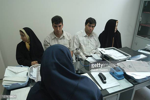 Couples sit in front of a specialist at Assad Abadi clinic in order to proceed with pre-marriage formalities in Tabriz, Iran, 13th July 2003.