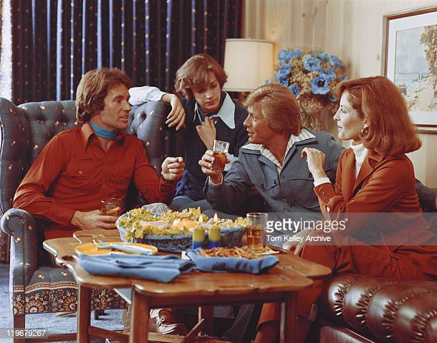 couples sitting in living room and having drink - 1976 stock pictures, royalty-free photos & images
