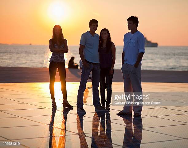 Couples standing on pier outdoors