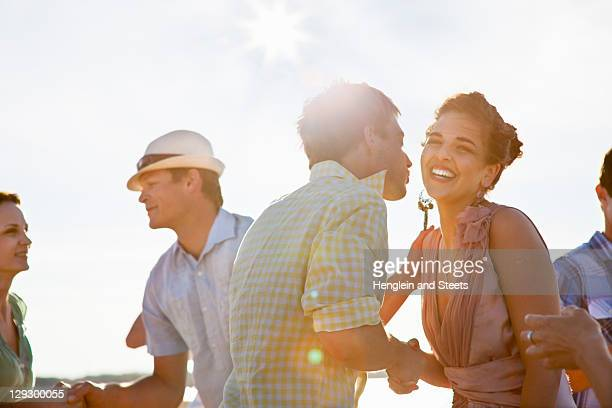 couples talking on beach - boyfriend stock pictures, royalty-free photos & images