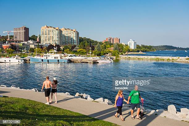 couples walk at waterfront promenade in barrie ontario canada - ontario canada stock pictures, royalty-free photos & images