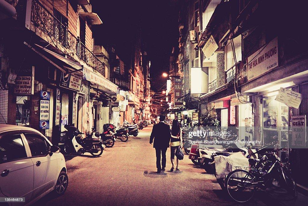 Couples walking on Hanoi street : Stock-Foto