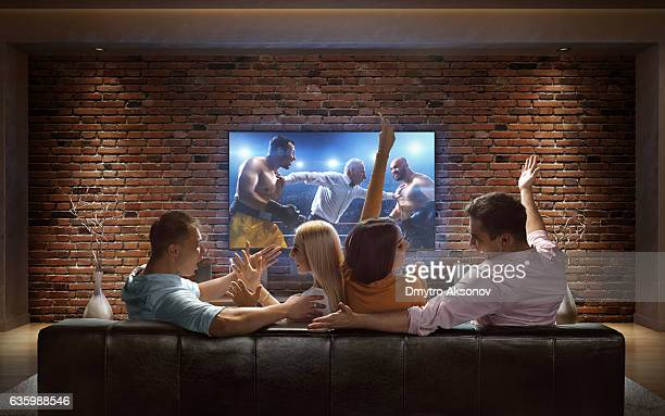 Couples watching Boxing at home