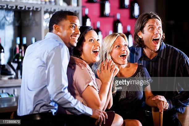 Couples watching sports at bar